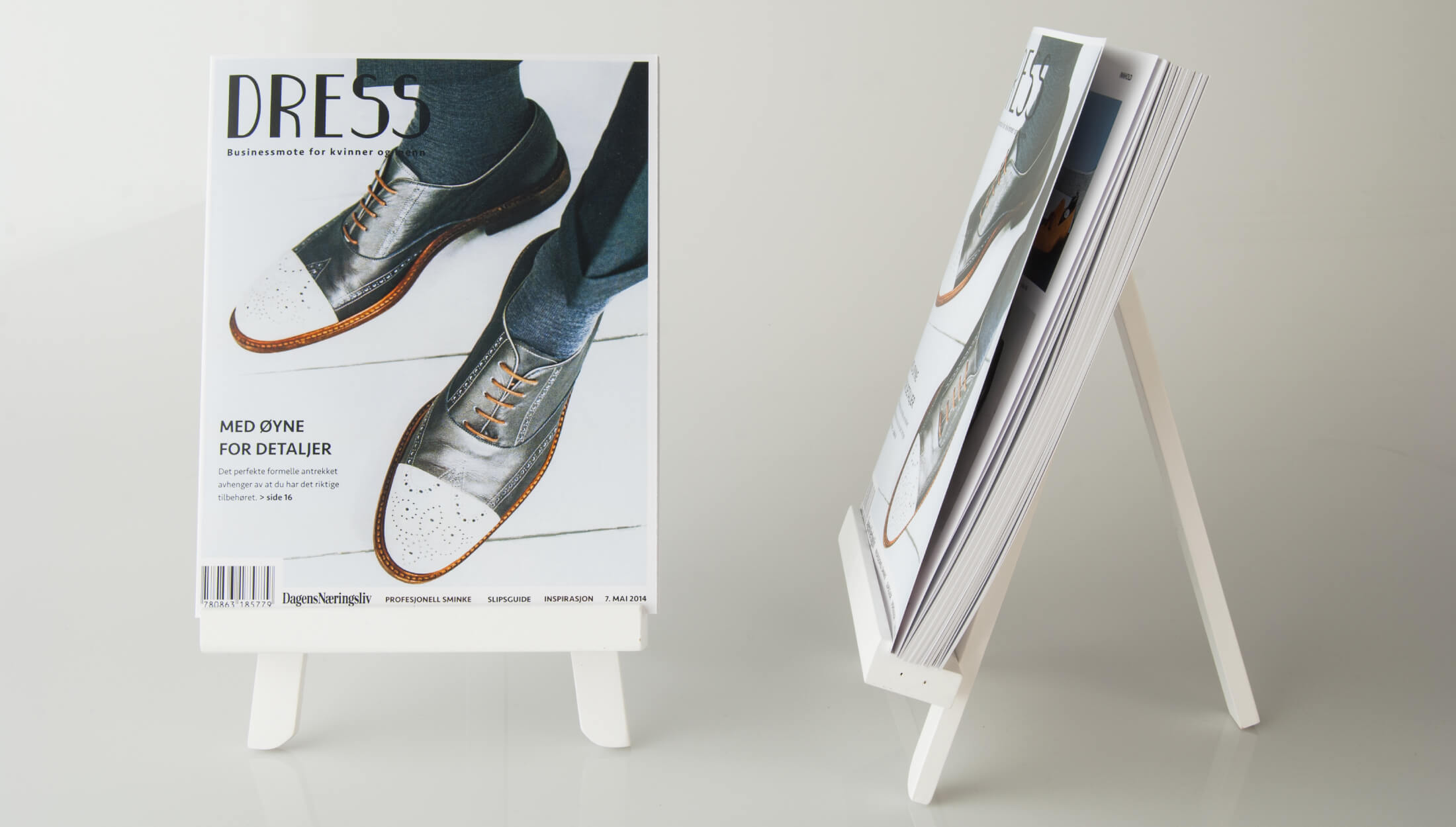 dress-magazine-front-page-on-easel